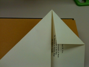 Fold left side in to the bottom and fold right side in to meet the left