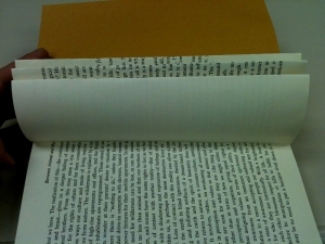 Fold page in half inside to the spine. Flatten crease.  Repeat until all pages are folded.