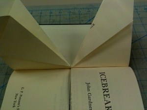 Fold page halves from the inner crease as shown.  Repeat until all pages are folded.